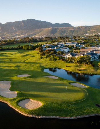 Steenberg Golf Course with sand traps and ponds near hills and houses