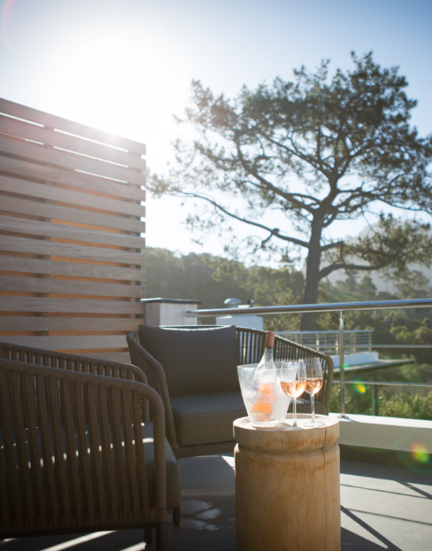 Chilled wine on the roof with chairs and trees at Villa Lion View
