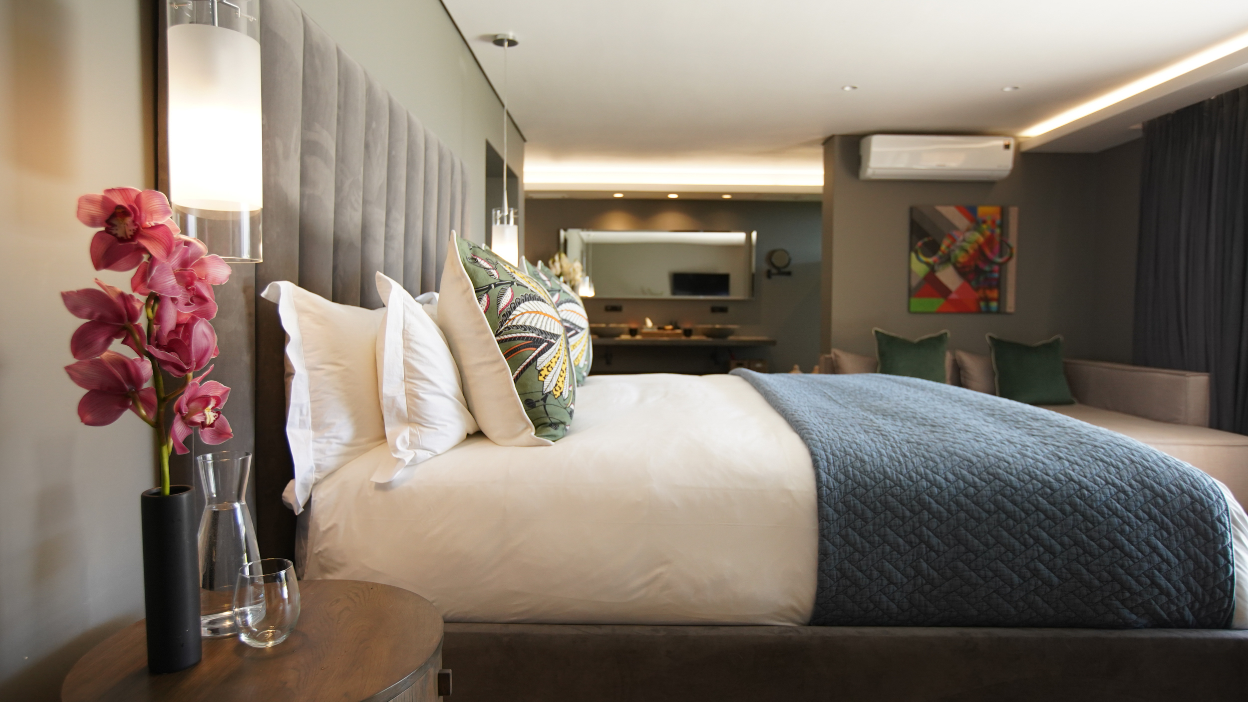 Bed in deluxe room at Villa Lion View