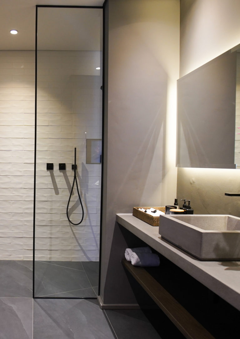 Walk in shower with mirror and sink in en-suite bathroom in luxury suite at Villa Lion View