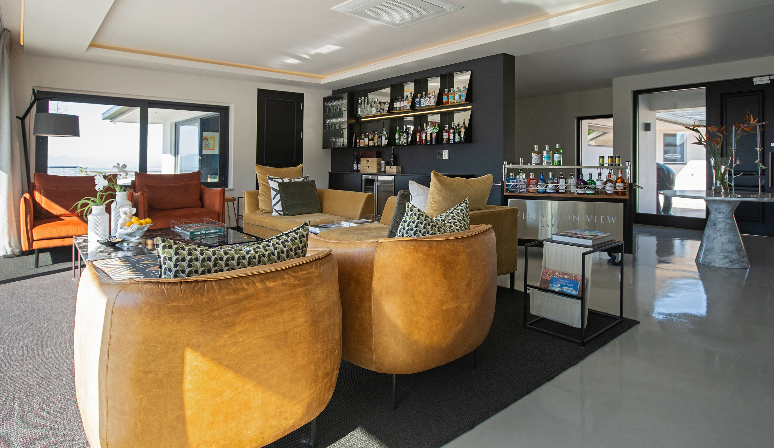Lounge with couches and chairs with a fully stocked bar at Villa Lion View