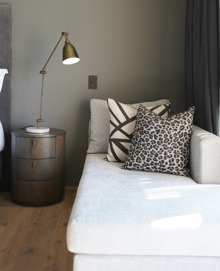 Couch and side table in luxury room at Villa Lion View