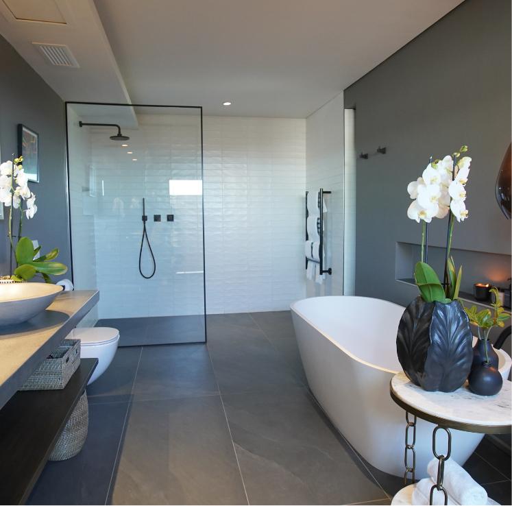 Walk in shower and bath in En-suite Bathroom in Deluxe Room at Villa Lion View