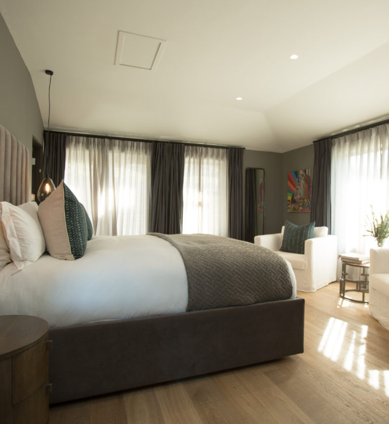Bed and seating in classic room suite at villa lion view
