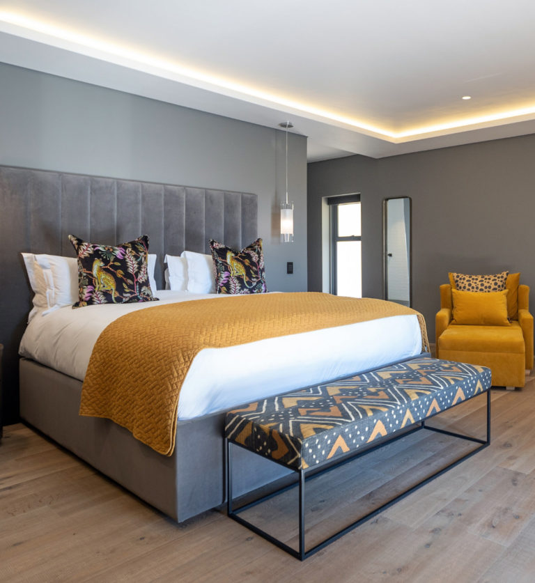 Large bed in the Deluxe Room at Villa Lion View