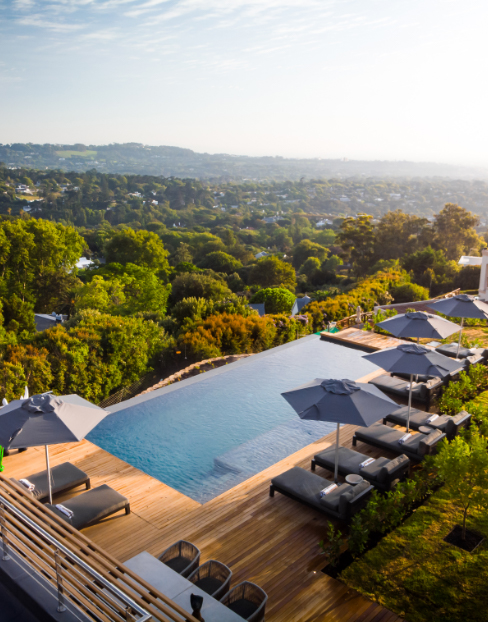 Infinity swimming pool with view over Constantia at Villa Lion View